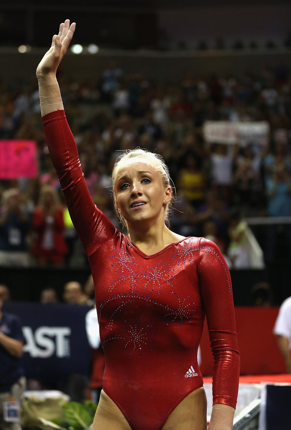 <b>Bowing out</b><br><br>Olympic gold medalist Nastia Liukin tearfully waves to the crowd after competing at the 2012 U.S. Olympic Gymnastics Team Trials on July 1, 2012. Liukin fell hard during her uneven bars routine, essentially putting an end to her hopes of going to London. However, like a true champion, Liukin returned to the bars to complete her performance before graciously saying goodbye to her adoring fans. (Photo by Ezra Shaw/Getty Images)