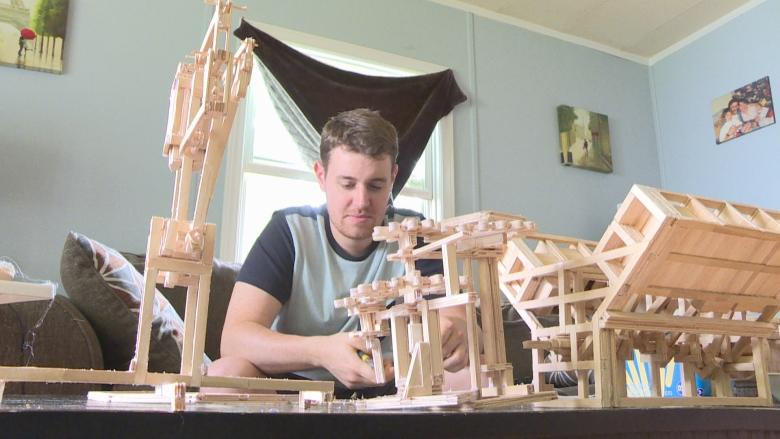 Artist builds everything from a cat castle to engines out of Popsicle sticks