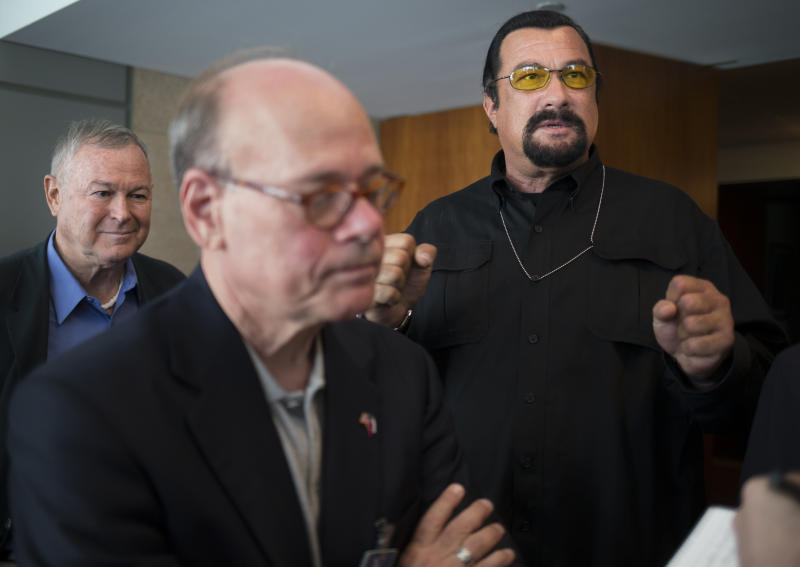 """Rep. Dana Rohrabacher, left, who is leading a U.S. Congressional delegation to the Russian Federation, Rep. Steven Cohen, center, and U.S. actor Steven Seagal, right, speak to the media after a news conference in U.S. Embassy in Moscow, Russia, Sunday, June 2, 2013. A U.S. Congressional delegation to Russia learned little about what could have been done to prevent the Boston Marathon bombings, but got to hang out with Steven Seagal. Rep. Dana Rohrabacher, a California Republican who led the six-person delegation this week, said at a press conference Sunday that there was """"nothing specific"""" that could have helped April's bombings, but that the U.S. and Russia needed to work more closely on joint security threats.(AP Photo/Alexander Zemlianichenko)"""
