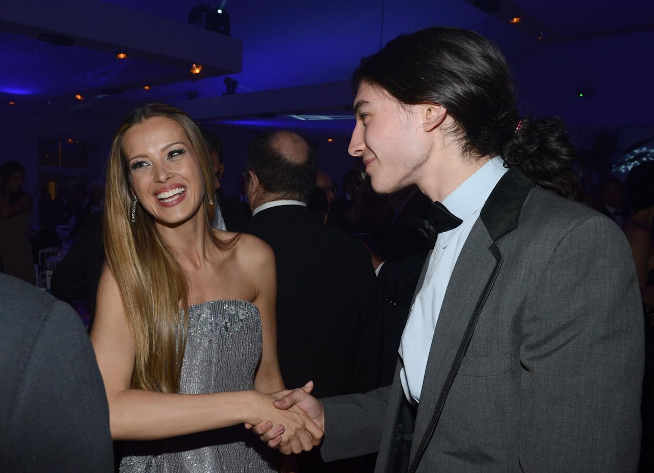 CANNES, FRANCE - MAY 18:  Model Petra Nemcova (L) and actor Ezra Miller attend the Haiti Carnival in Cannes Benefitting J/P HRO, Artists for Peace and Justice & Happy Hearts Fund Presented By Armani during the 65th Annual Cannes Film Festival on May 18, 2012 in Cannes, France.  (Photo by Michael Buckner/Getty Images)