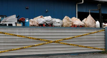 Plastic waste is piled on a truck in an illegal recycling factory sealed off by the authorities in Jenjarom, Kuala Langat, Malaysia October 14, 2018. Picture taken October 14, 2018. REUTERS/Lai Seng Sin/Files