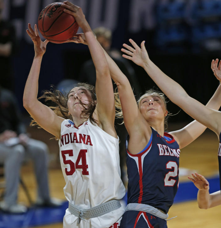 Indiana forward MacKenzie Holmes (54) grabs a rebound next to Belmont forward Conley China (20) during the first half of a college basketball game in the second round of the NCAA women's tournament at Greehey Arena in San Antonio on Wednesday, March 24, 2021. (AP Photo/Ronald Cortes)