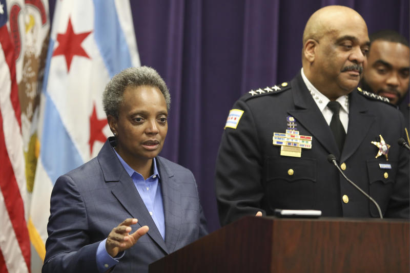 """FILE - In this Nov. 7, 2019 file photo, Mayor Lori Lightfoot speaks as Chicago Police Superintendent Eddie Johnson announces his retirement after more than three years leading the department in Chicago. Mayor Lightfoot  fired Police Supt. Eddie Johnson Monday Dec. 2, 2019, due to his """"ethical lapses.""""(AP Photo/Teresa Crawford File)"""
