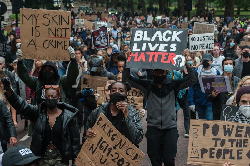 LONDON, ENGLAND - JUNE 12: Protestors march towards Parliament square from Hyde Park as several thousand people attend a Black Lives Matter protest on June 12, 2020 in London, England. The death of an African-American man, George Floyd, has sparked protests across the world. (Photo by Guy Smallman/Getty images)