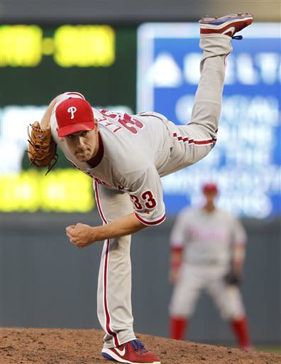 Philadelphia Phillies starting pitcher Cliff Lee throws against the Minnesota Twins during the third inning of a baseball game on Thursday, June 13, 2013, in Minneapolis. (AP Photo/Genevieve Ross)