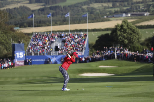 Danielle Kang of the U.S plays the 15th hole in the Four balls match against Europe in the Solheim cup at Gleneagles, Auchterarder, Scotland, Friday, Sept. 13, 2019. (AP Photo/Peter Morrison)