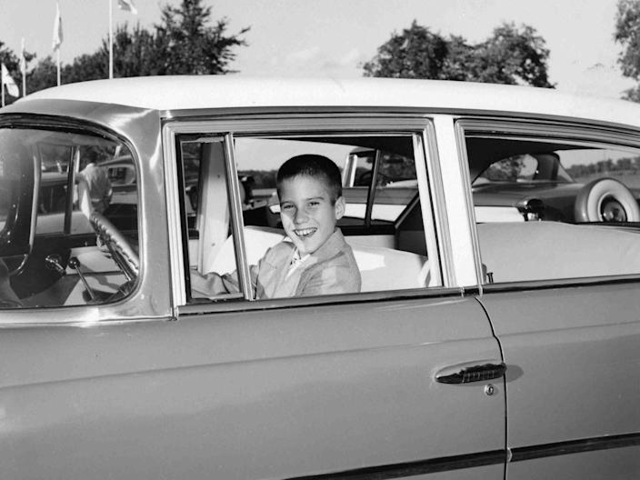 Mitt Romney in an archive family photo in a Nash automobile, 1957.