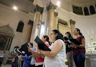 A choir prepares for celebrations of upcoming Pope Francis to Egypt, at Saint Joseph's Roman Catholic Church, in Cairo, Egypt April 23, 2017. Picture taken April 23, 2017. REUTERS/Mohamed Abd El Ghany