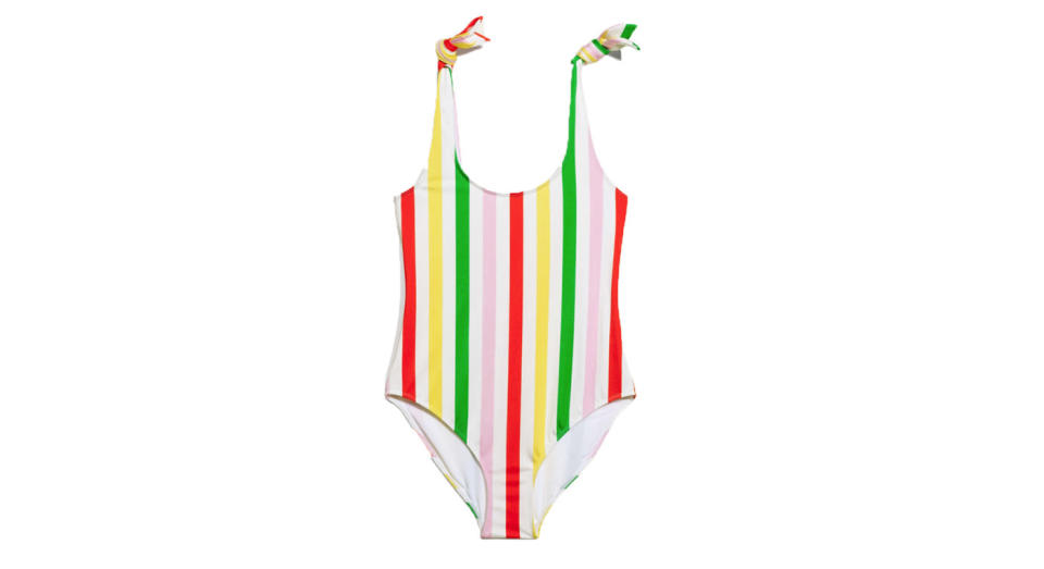 """<p>Off for some sun soon? Up your swimwear game in this striped number. <a rel=""""nofollow noopener"""" href=""""https://www.stories.com/gb/Swimwear/All_Swimwear/Stripe_Swimsuit/108412542-0585911003.2"""" target=""""_blank"""" data-ylk=""""slk:Buy here."""" class=""""link rapid-noclick-resp""""><em>Buy here.</em></a> </p>"""