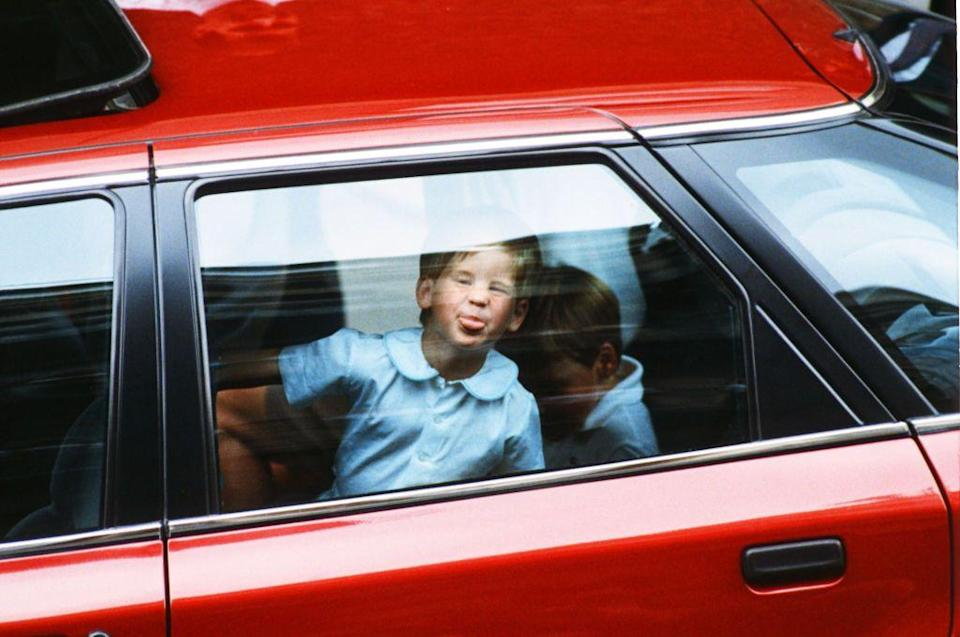 <p>A young Prince Harry sticks out his tongue and presses his face against the car window after visiting the Duchess of York and baby Princess Beatrice. <br></p>