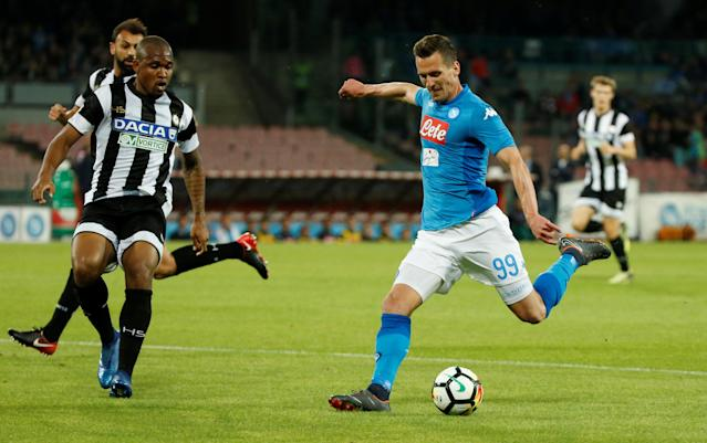 Soccer Football - Serie A - Napoli vs Udinese Calcio - Stadio San Paolo, Naples, Italy - April 18, 2018 Napoli's Arkadiusz Milik in action with Udinese's Samir REUTERS/Ciro De Luca