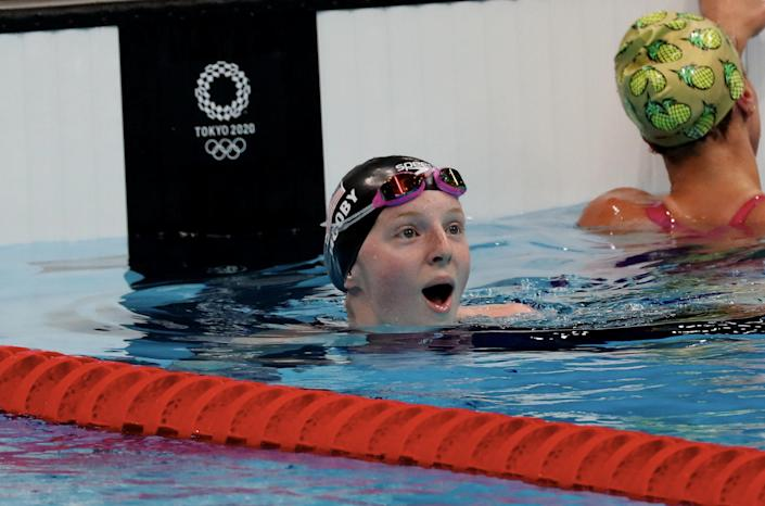 Lydia Jacoby, who won gold at the Tokyo Olympics, looks at the scoreboard to see she's taken the gold in a state of shock.