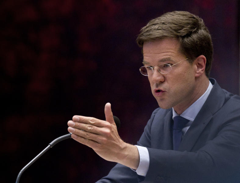 Caretaker Prime Minister Mark Rutte addresses parliament in The Hague, Netherlands, Tuesday April 24, 2012. Rutte appealed to a polarized Dutch Parliament on Tuesday to help him get the economy back on track rather than let the country drift in political limbo until new elections. Speaking publicly for the first time since he tendered his resignation Monday, Rutte said the nation, long considered one of Europe's most fiscally responsible, has no time to waste in tackling its economic woes. (AP Photo/Peter Dejong)