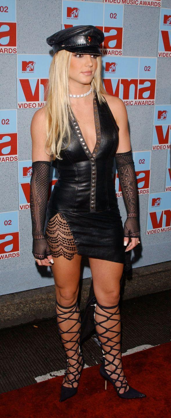 <p>Britney Spears wears a dramatic leather mini dress at the 2002 MTV Video Music Awards in New York on August 29, 2002.</p>