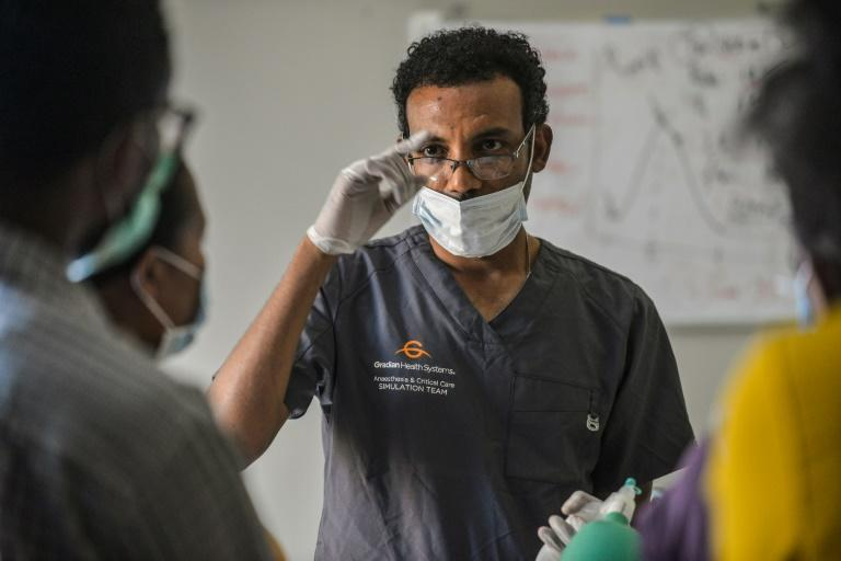Habtamu Kehali gives doctors a refresher course in how to use the ventilators, which are used for patients whose lungs have been immpaired by coronavirus infection (AFP Photo/Michael Tewelde)