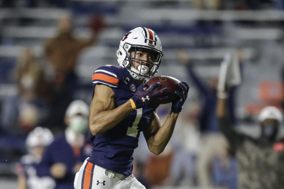 Auburn wide receiver Anthony Schwartz catches a pass for a touchdown during the first half of the team's NCAA college football game against Tennessee on Saturday, Nov. 21, 2020, in Auburn, Ala. (AP Photo/Butch Dill)
