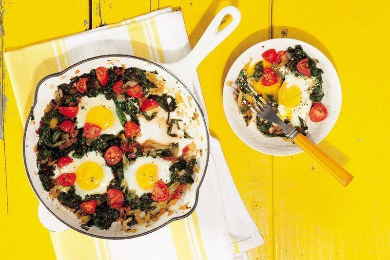 """<p>Greens belong in more than just salads—especially chard, which gets much better after it's been baked. Enjoy it in this comforting meal, which is surprisingly easy to make; just throw all the ingredients in a skillet, crack a few eggs, and sit back.</p><p><a href=""""https://www.prevention.com/food-nutrition/recipes/a20521017/chard-breakfast-skillet-with-egg-onion-and-tomato/"""" rel=""""nofollow noopener"""" target=""""_blank"""" data-ylk=""""slk:Get the recipe »"""" class=""""link rapid-noclick-resp""""><strong><em>Get the recipe »</em></strong></a></p>"""