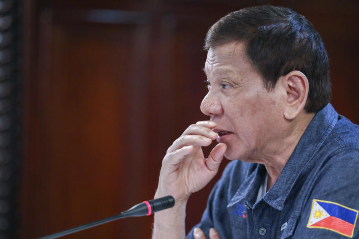 In this May 11, 2020, photo provided by the Malacanang Presidential Photographers Division, Philippine President Rodrigo Duterte talks during a meeting at the Malacanang presidential palace in Manila, Philippines. The Philippine president says a massive lockdown that has restricted millions to their homes will be eased but warned those who will be allowed to go back to work to follow safeguards to avoid more deaths and a second wave of COVID-19 outbreaks. (Ace Morandante/Malacanang Presidential Photographers Division via AP)