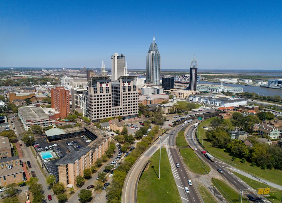 Aerial view of the Downtown Mobile, Alabama skyline and cityscape on a clear day