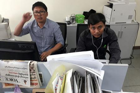Reuters journalists Wa Lone (L) and Kyaw Soe Oo, who are based in Myanmar, pose for a picture at the Reuters office in Yangon, Myanmar December 11, 2017. Picture taken December 11, 2017. REUTERS/Antoni Slodkowski