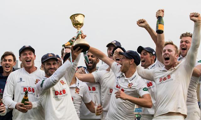 Ryan ten Doeschate (centre left) and his Essex team celebrate with the Division One trophy at Chelmsford.