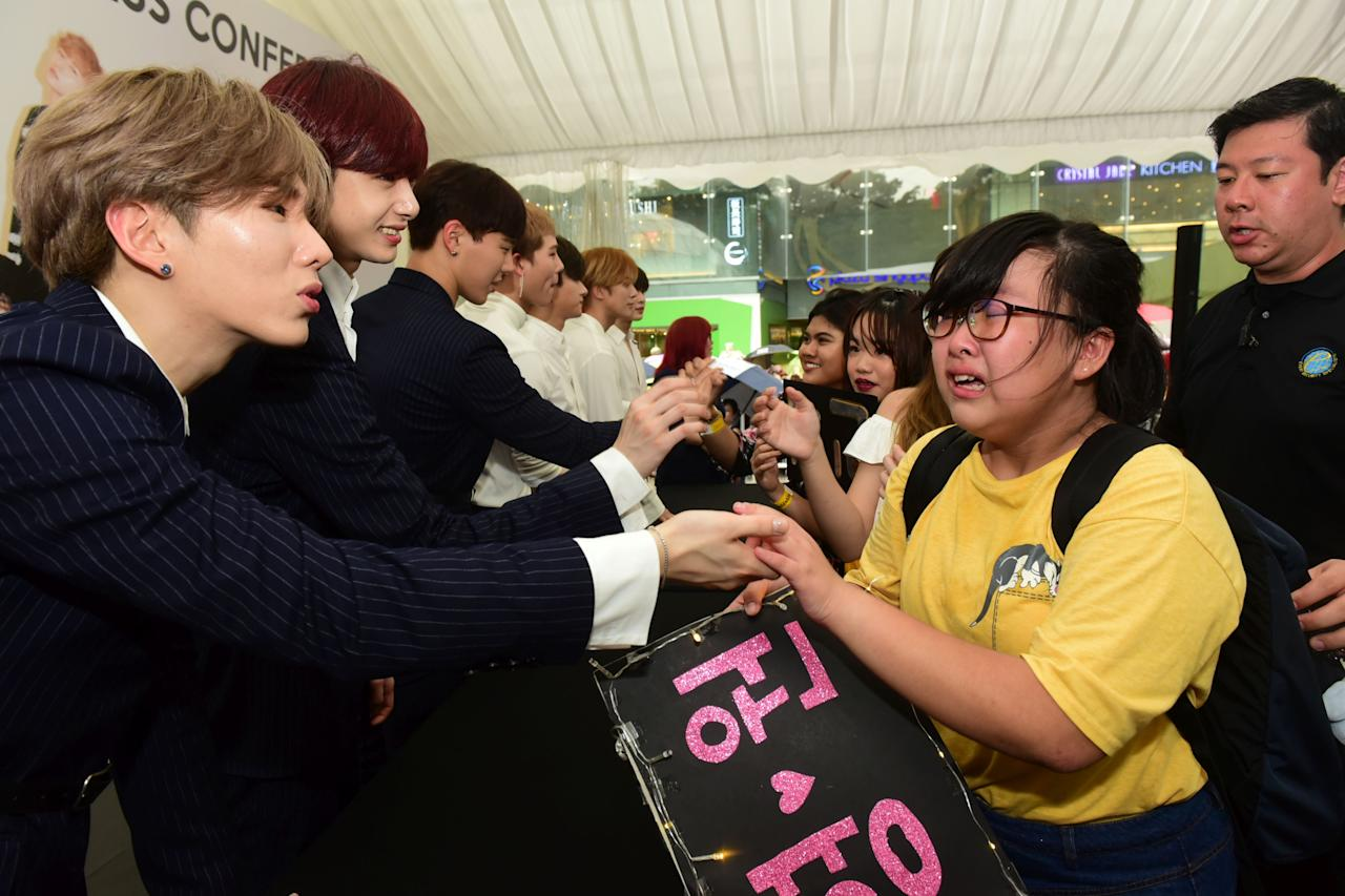 PHOTOS: Crowds brave rain to see K-pop group Monsta X at Plaza Singapura