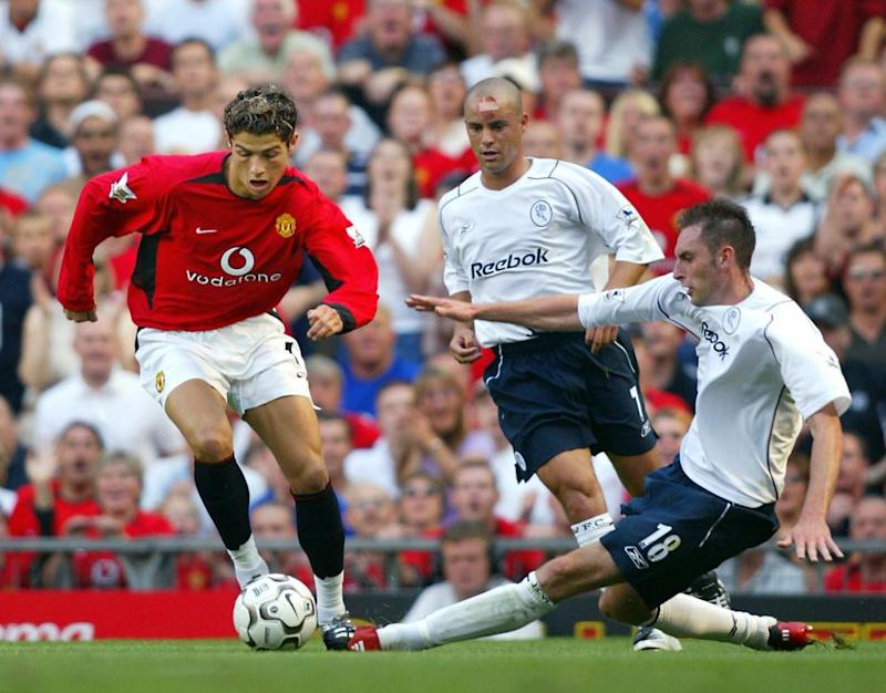 Cristiano Ronaldo slalom's away from Bolton's Stylianos Giannakopoulos (centre) and Nicky Hunt on a stunning Old Trafford debut in 2003,