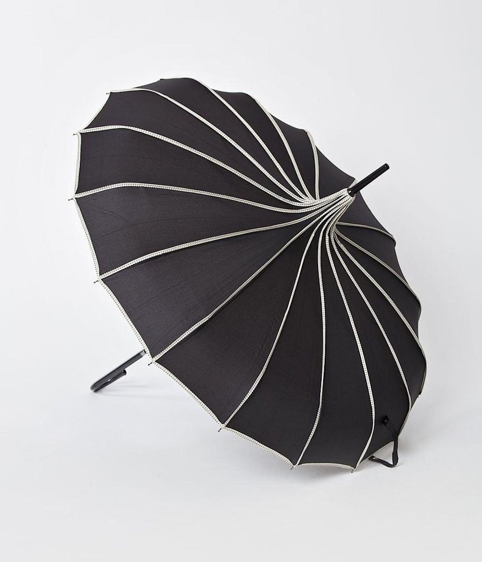 <p>Don't melt in the rain, witches! Instead, opt for this <span>Vintage Style Black and Polka Dot Tan Princess Pagoda Umbrella</span> ($42).</p>