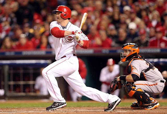 CINCINNATI, OH - OCTOBER 09: Scott Rolen #27 of the Cincinnati Reds hits an infield single in the sixth inning against the San Francisco Giants in Game Three of the National League Division Series at the Great American Ball Park on October 9, 2012 in Cincinnati, Ohio. (Photo by Andy Lyons/Getty Images)