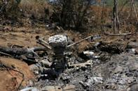 The wreckage of a military helicopter is pictured at the crash site near Villa Purificacion, Mexico, May 5, 2015. REUTERS/Stringer/File Photo