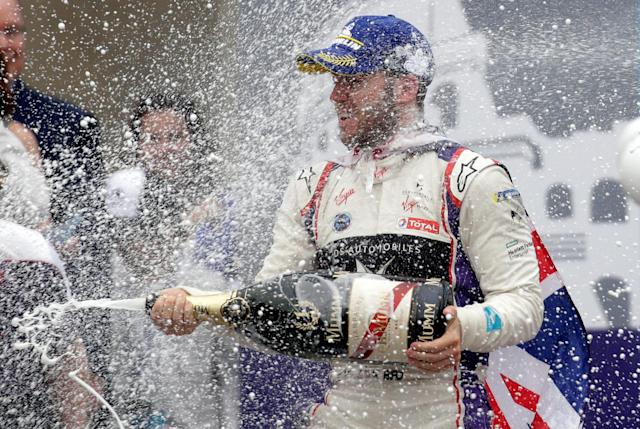 Motor Racing - Formula E - Rome ePrix - Rome, Italy - April 14, 2018 DS Virgin Racing's Sam Bird celebrates winning the race by spraying champagne during the podium ceremony REUTERS/Max Rossi
