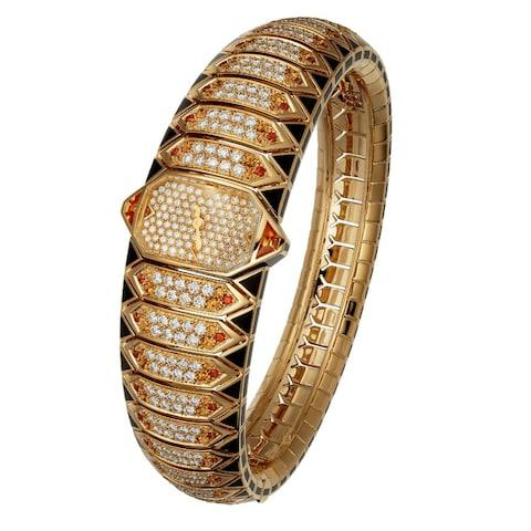 Cartier Serpent Graphique Dore watch in yellow gold with black lacquer, garnets, spessartite garnets and diamonds