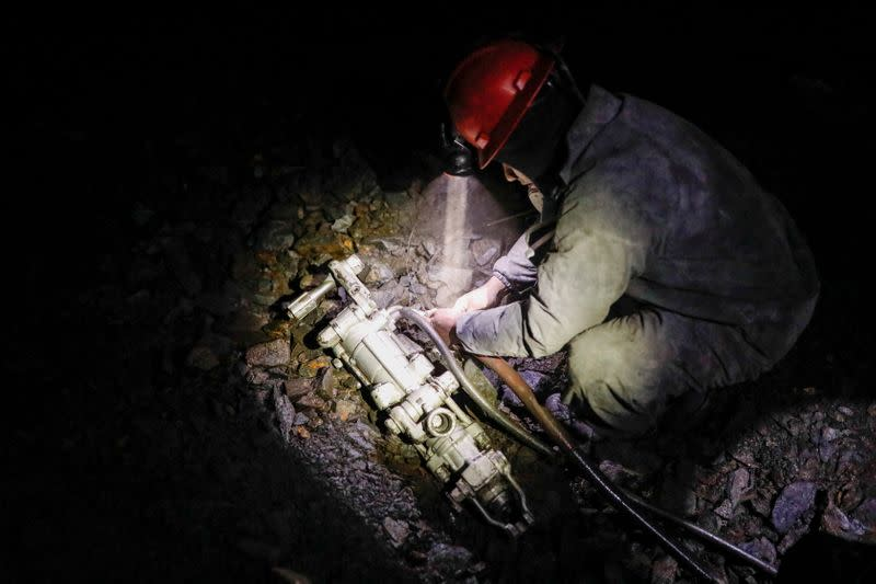 An artisanal gold miner works in a gold mine in La Rinconada, in the Andes, Peru