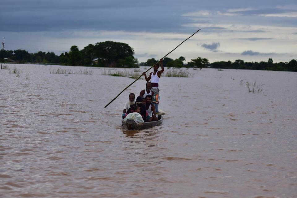 NAGAON,INDIA-JULY 22,2020 :Flood affected villagers are transported on a boat towards a safer place at a village in Nagaon district of Assam ,india - PHOTOGRAPH BY Anuwar Ali Hazarika / Barcroft Studios / Future Publishing (Photo credit should read Anuwar Ali Hazarika/Barcroft Media via Getty Images)