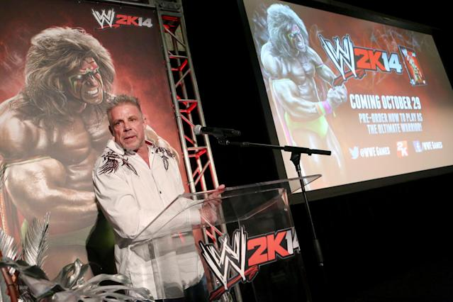 IMAGE DISTRIBUTED FOR 2K - Warrior talks about his career as the Ultimate Warrior, a playable WWE Legend, available exclusively by pre-ordering WWE 2K14, on Sunday, Aug. 18, 2013 in Los Angeles. (Photo by Casey Rodgers/Invision for 2K/AP Images)