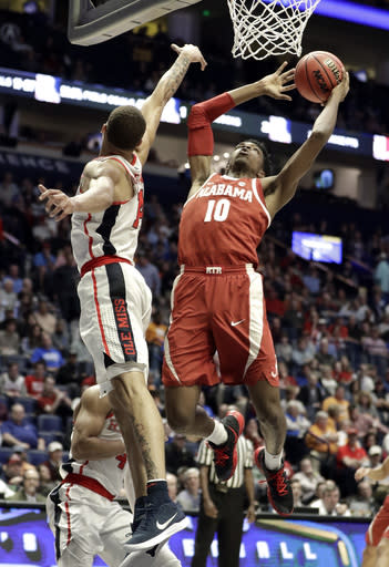 Alabama guard Herbert Jones (10) shoots against Mississippi forward KJ Buffen (14) in the first half of an NCAA college basketball game at the Southeastern Conference tournament Thursday, March 14, 2019, in Nashville, Tenn. (AP Photo/Mark Humphrey)