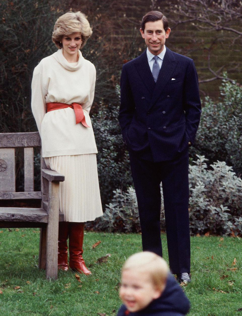 <p>The royal mom put her own spin on a white turtleneck sweater by cinching it at the waist.</p>