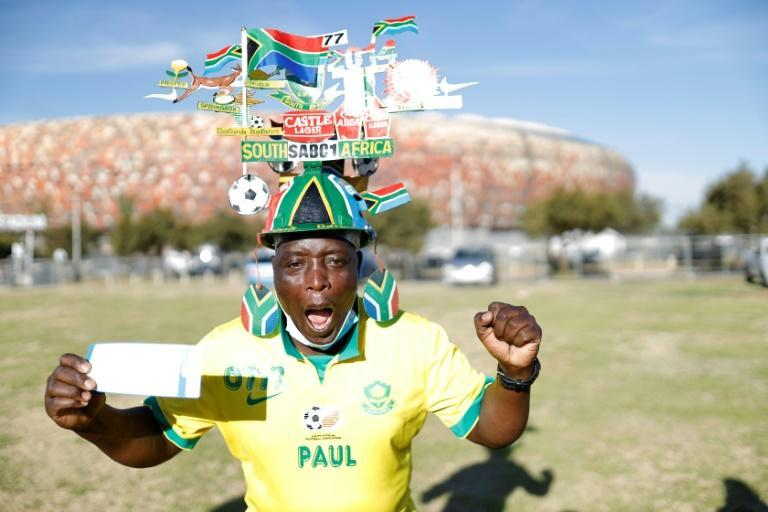 Just the ticket: South African Paul Nkosi shows off his precious ticket (AFP/GUILLEM SARTORIO)
