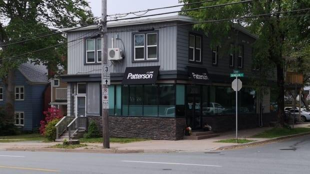 The property owner of this law firm at the corner of Quinpool Road and Quinn Street says she recently discovered the building's commercial designation could change under HRM's Centre Plan. (Alex Guye/ CBC - image credit)