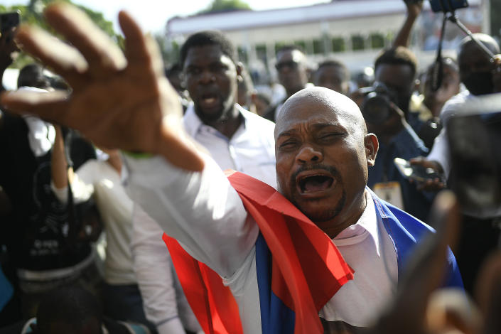 A man attends the funeral of slain Haitian President Jovenel Moise, at Moise's family home in Cap-Haitien, Haiti, Friday, July 23, 2021. Moise was assassinated at his home in Port-au-Prince on July 7. (AP Photo/Matias Delacroix)