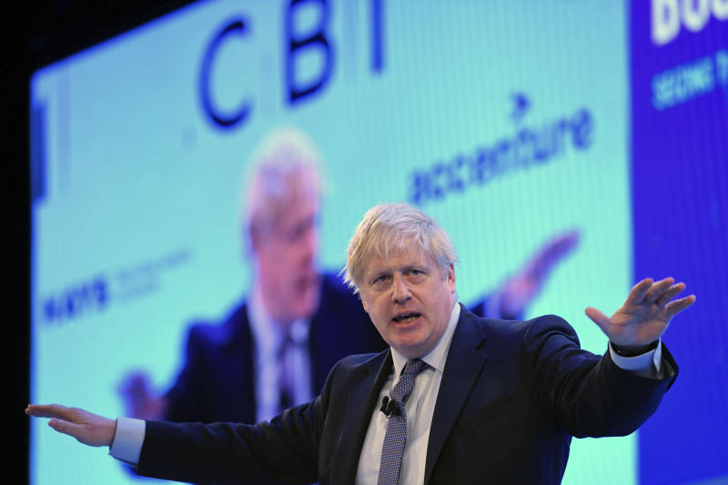 Britain's Prime Minister Boris Johnson speaking at the Confederation of British Industry (CBI) annual conference in London, Monday Nov. 18, 2019. Britain's Brexit is one of the main issues for political parties and for voters, as the UK goes to the polls in a General Election on Dec. 12. (Stefan Rousseau/PA via AP)