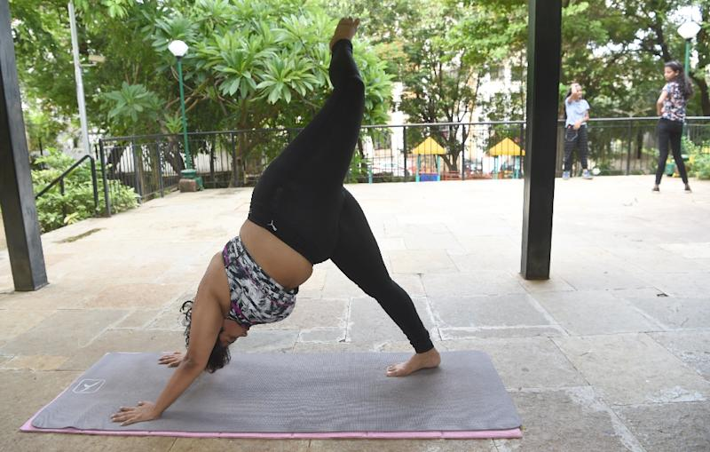 Dolly Singh has gained something of a fan following online for promoting body positivity by showing that size is no barrier to mastering complex yoga moves (AFP Photo/INDRANIL MUKHERJEE        )