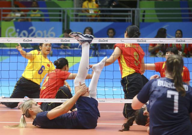 2016 Rio Paralympics - Sitting Volleyball - Final - Women's Gold Medal Match - Riocentro Pavilion 6 - Rio de Janeiro, Brazil, 17/09/2016. Lora Webster (USA) of the United States lies on the ground. REUTERS/Pilar Olivares FOR EDITORIAL USE ONLY. NOT FOR SALE FOR MARKETING OR ADVERTISING CAMPAIGNS.