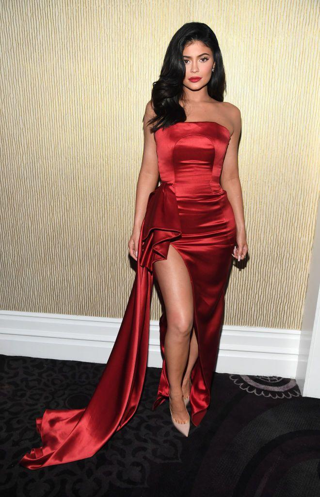 <p>Jenner wore a red dress to the Pre-GRAMMY Gala.</p>