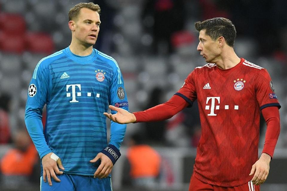 Bayern Munich's Germany goalkeeper Manuel Neuer and Polish forward Robert Lewandowski count the cost of their Champions League exit (AFP Photo/Christof STACHE )