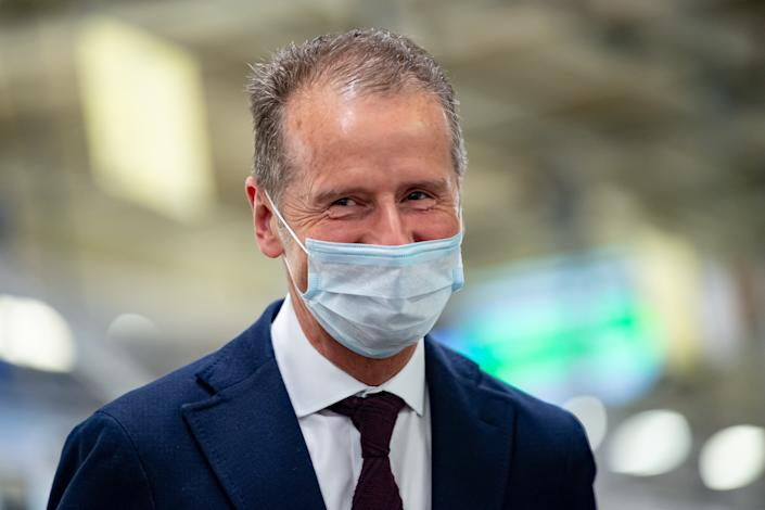 WOLFSBURG, GERMANY - APRIL 27: Herbert Diess, Chairman of the Board of Management of Volkswagen AG wearing a face mask visits the production line at the Wolfsburg Plant on April 27, 2020 in Wolfsburg, Germany. Production was shut down in March due to both to lockdown measures designed to stem the spread of the virus and the breakdown of international supply chains. Germany is taking steps to lift lockdown measures in a careful attempt to get the economy back into gear. (Photo by Swen Pförtner - PoolGetty Images)