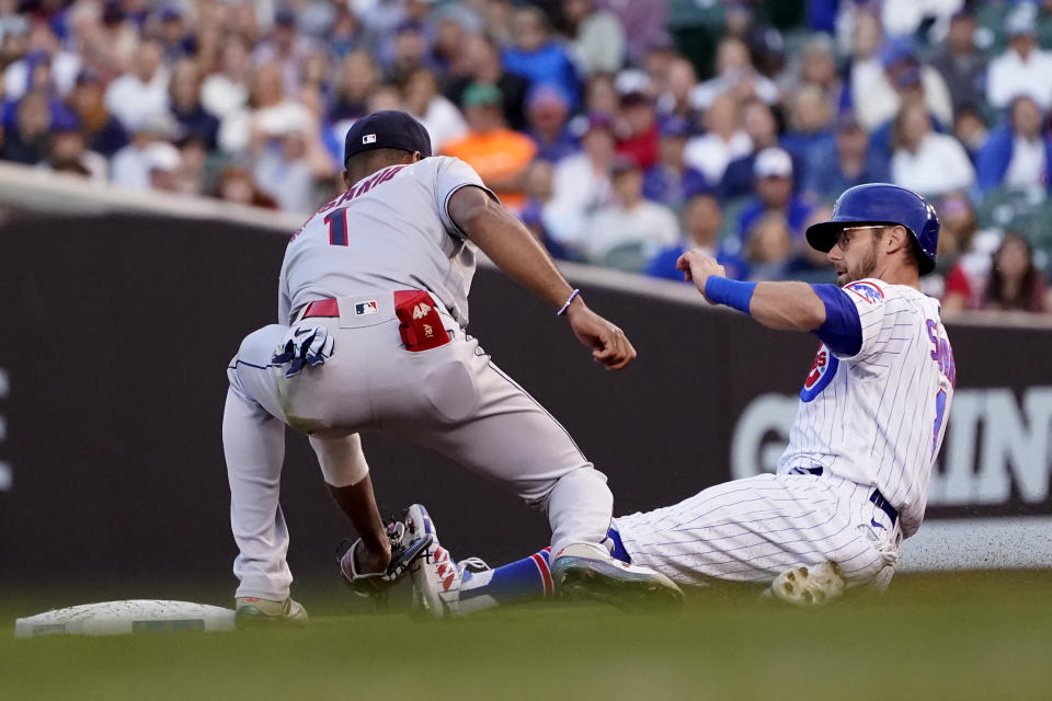 Cleveland Indians' Amed Rosario (1) catches Chicago Cubs' Eric Sogard, right, trying to steal second to end the third inning of a baseball game Monday, June 21, 2021, in Chicago. (AP Photo/Charles Rex Arbogast)