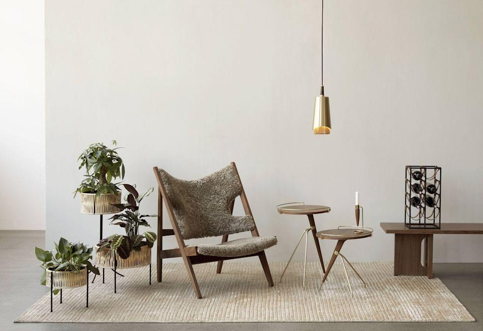 """<p>Originally designed and launched in 1951 as a limited edition, this cosy, low-slung armchair by Danish modernist Ib Kofod-Larsen is now produced by Menu. Available in natural oak, stained oak and walnut with coordinating sheepskin upholstery, it makes an inviting spot in any corner of the home. Approx £2,463, <a href=""""https://menuspace.com/"""" rel=""""nofollow noopener"""" target=""""_blank"""" data-ylk=""""slk:menuspace.com"""" class=""""link rapid-noclick-resp"""">menuspace.com</a></p>"""