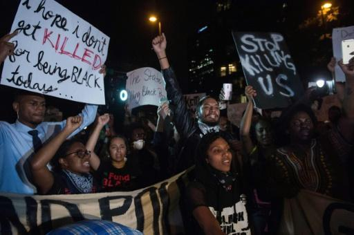 Police fire tear gas at Charlotte protesters blocking highway