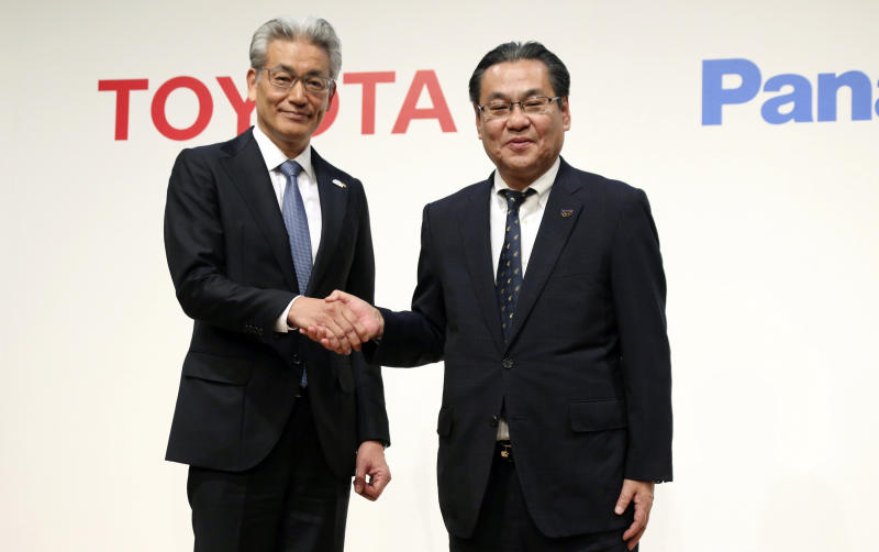 Operating Officer of Toyota Motor Corporation Masayoshi Shirayanagi, left, and senior Managing Executive Officer of Panasonic Corporation Makoto Kitano shake hands after their press conference in Tokyo, Thursday, May 9, 2019. Japanese automaker Toyota and electronics maker Panasonic are forming a joint venture combining their housing businesses in Japan. (AP Photo/Koji Sasahara)